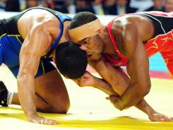 Jordan Burroughs of the USA (right) wrestles with Iran's Sadegh Saeed Goudarzi during their freestyle gold-medal match at the Wrestling World Championship in Istanbul, on Sept. 17.