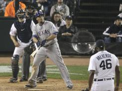 Rangers' Nelson Cruz, center, watches his three-run homer off Tigers reliever Jose Valverde leave Comerica Park in the 11th inning.