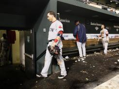 Red Sox shortstop Marco Scutaro walks out of the dugout after a loss to the Orioles on the last game of the season.