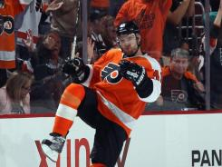 Andrej Meszaros celebrates his third-period goal that broke a 4-4 tie, lifting the Flyers to a victory over the Canucks. The goal was the first of the season for Meszaros.
