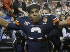 The NCAA found no evidence Cam Newton, seen here after winning the BCS national championship game Jan. 10, knew his father sought payment.