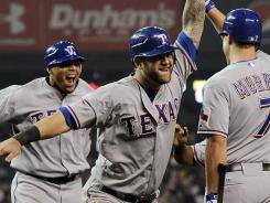 From left: Nelson Cruz, Mike Napoli and David Murphy celebrate Cruz's three-run homer in the 11th inning, capping the Texas Ranger's 7-3 win over the Detroit Tigers on Wednesday.
