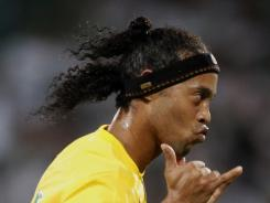 Ronaldinho connected on a trademark freekick into the top right corner of the net in the 80th minute, setting up a game winner by Marcelo four minutes later.