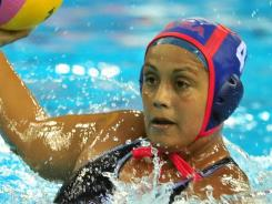 Brenda Villa of the United States looks to pass against the Netherlands as they play to a 7-7 draw in the opening match of women's water polo at the 14th FINA World Championships in July. Villa is playing at the upcoming Pan American Games in Mexico.