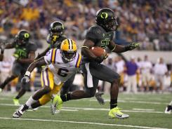 Junior Kenjon Barner, one of three talented backup running backs at Oregon,  averages 6.2 yards a carry.