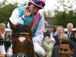 Jockey Tom Queally celebrates after a win by Frankel in England in July.