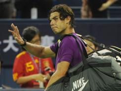 Rafael Nadal of Spain, who lost Thursday in the Shanghai Masters, says he won't play the Wimbledon warm-up at Queen's  Club next year.