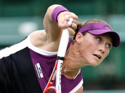 Samantha Stosur of Australia serves up a victory Thursday against Misaki Doi of Japan.