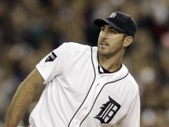 The Tigers' Justin Verlander watches a home run by the Rangers' Nelson Cruz on Thursday during the eighth inning of Game 5. Verlander willed the ball foul, to no avail.