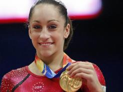 The USA's Jordyn Wieber smiles with the gold medal on the podium after winning the women's individual all-round final at  the Artistic Gymnastics World Championships in Tokyo on Thursday.