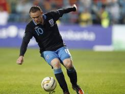 England's Wayne Rooney controls the ball during their group G Euro 2012 qualifying soccer match against Montenegro, in Podgorica, Montenegro, on Oct. 7. During the match, Rooney received a red card for kicking a Montenegro defender.