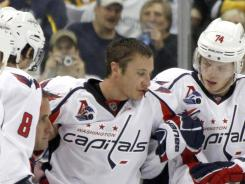 Jay Beagle is helped off the ice after his fight with Arron Asham.
