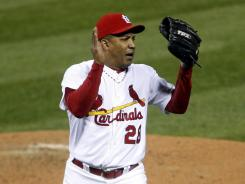Octavio Dotel picked up the win as he and three other Cardinals pitchers combined for four-pluse innings of two-hit relief.