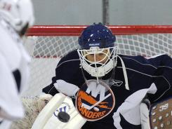 Rick DiPietro, shown here in training camp, was hit in the mask by a shot at practice and has a concussion.