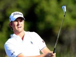Webb Simpson lost the lead at the McGladrey Classic, shooting a second-round 3-under 67 to fall into a tie for second with Michael Thompson, two strokes behind leader Billy Horschel.