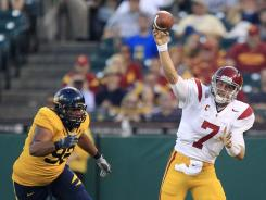 Marqise Lee and Brandon Carswell caught touchdown passes from Matt Barkley (7) as USC extended its win streak to eight against Cal.