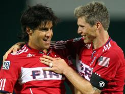Sebastian Grazzini, left, and Logan Pause celebrate the Chicago Fire's victory over D.C. United on Saturday.
