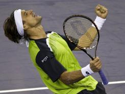 David Ferrer of Spain celebrates after he defeated his compatriot Feliciano Lopez in the semifinals of the Shanghai Masters.