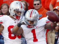 Ohio State Buckeyes running back Dan Herron, right, celebrates with wide receiver Chris Fields after scoring a touchdown against Illinois on Saturday.