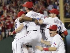 The Rangers react to winning  the ALCS against the Tigers 15-5 in Game 6.