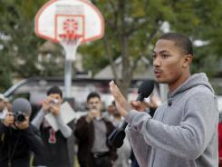 Derrick Rose, seen here at the unveiling of a newly restored basketball court in Chicago on Sept. 27, blames the owners for the NBA lockout.
