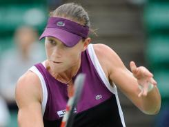 Samantha Stosur of Australia lines up a backhand during her victory Saturday against Chanelle Scheepers of South Africa.