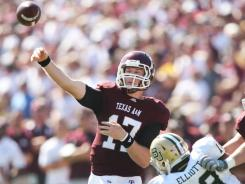 Aggies quarterback Ryan Tannehill (17) threw for a career-high six touchdowns against Baylor in College Station, Texas.