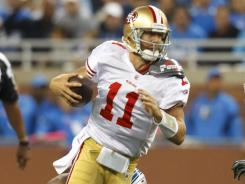 San Francisco 49ers quarterback Alex Smith breaks a tackle by Detroit Lions defensive tackle Nick Fairley during their meeting in Detroit.