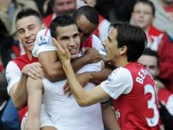 Arsenal's Robin van Persie (second from left) celebrates with teammates Theo Walcott, (second from right) Laurent Koscielny (left) and Yossi Benayoun after scoring a goal against  Sunderland during their English Premier League soccer match at the Emirates stadium, London, Sunday.