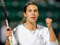 Marion Bartoli of France celelbrates her victory Sunday against Samantha Stosur of Australiain the Japan Open.