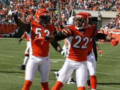 Bengals linebacker Thomas Howard (53) and cornerback Nate Clements (22) celebrate recovering a fumble from Colts tight end Dallas Clark in Cincinnati's 27-17 victory against Indianapolis.