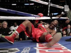 Hopkins was stopped for the first time in his career in bizarre fashion when Dawson lifted him and tossed him to the canvas late in the second round.