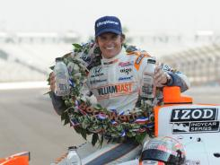 Dan Wheldon poses by his car with the Borg-Warner wreath after winning the 2011 Indianapolis 500. Wheldon also won IndyCar's premier race in 2005.