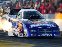 NHRA funny car driver Jack Beckman powered his Dodge Charger to a 4.354-second run at 278.29 mph in the final round to beat Don Schumacher Racing teammate Johnny Gray.