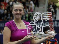 Petra Kvitova shows the trophy after winning the final  against Dominika Cibulkova at the  Generali Ladies in Linz, Austria.