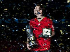 Andy Murray of Britain and his trophy are showered with confetti after winning the Shanghai Masters on Sunday.