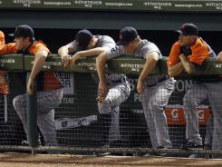 The Tigers dugout reacts to the nine-run third inning in Game 6 of the ALCS.
