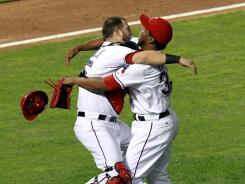Rangers' Mike Napoli, left,  and Neftali Feliz celebrate winning Game Six of the ALCS to advance to the World Series.