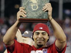 Rangers'  Nelson Cruz holds the ALCS MVP  trophy after winning Game 6.