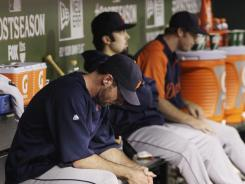 Tigers' Justin Verlander and his teammates react during the 15-5 loss to the Rangers in Game 6.