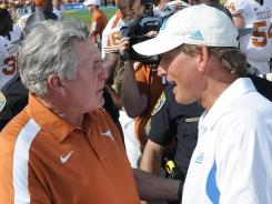 Texas coach Mack Brown shakes hands with UCLA coach Rick Neuheisel following the Longhorns' 49-20 win in September.