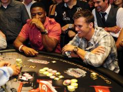 Dan Wheldon plays blackjack at the IndyCar Charity Blackjack Tournament on Thursday at the MGM Grand in Las Vegas. He died following a crash two days later.