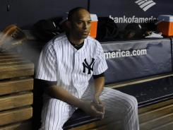 Yankees closer Mariano Rivera watches after pitching in Game 5 of the division series, when the host Yankees were eliminated by the Tigers. Four of this year's six postseason series ended with the road team winning and advancing.