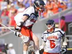 Defending champion Virginia, with a lineup featuring Matt White, left, and Steele Stanwick, is a featured attraction for the Face-Off Classic in March.