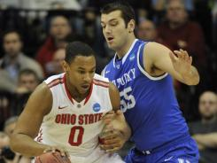 Lighten his load:  Jared Sullinger, here posting up Kentucky's Josh Harrellson in the Sweet 16, carried 280 pounds on his 6-9 frame last season. The Ohio State forward has dropped fat through a diet and exercise regimen.