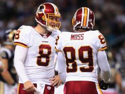 Rex Grossman and Santana Moss of the Washington Redskins speak during their Oct. 2 game against the Rams.