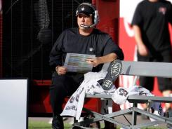 Saints head coach Sean Payton watches his team from the bench after he was injured in the first quarter against the Tampa Bay Buccaneers.