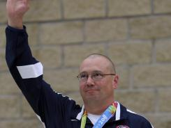 Gold medalist Daryl Lee Szarenski waves during the men's 10-meter air pistol shooting event medal ceremony at the 2011 Pan American Games in Guadalajara, Mexico, on Sunday.