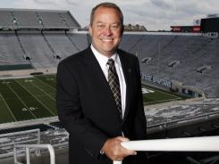 Michigan State athletic director Mark Hollis is fine with taking less money to work at his alma mater.