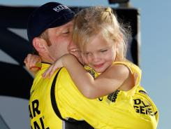 Ed Carpenter hugs his daughter Makenna after winning the Kentucky Indy 300 on Oct. 2.